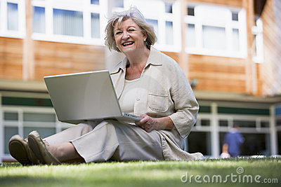 Senior woman using laptop on campus