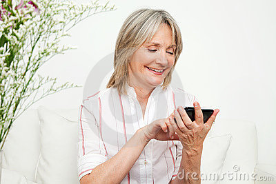 Senior Woman Using Smartphone Stock Images - Image: 23248764