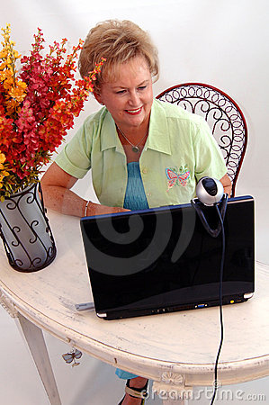 Senior woman using webcam