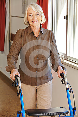 Senior woman with walker in rest