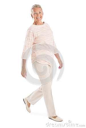 Senior Woman Walking Against White Background