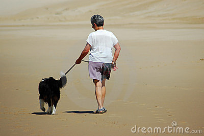 Senior woman walking her dog