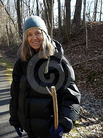Senior woman: walking in winter and smiling