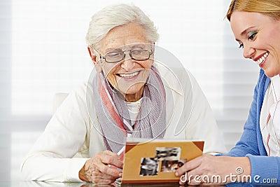 Senior woman watching photo album