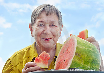 Senior woman with watermelon