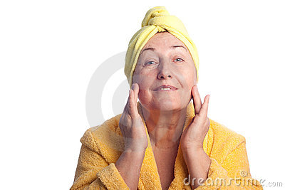 Senior woman wearing yellow towel