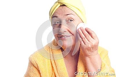 Senior woman wearing yellow towel