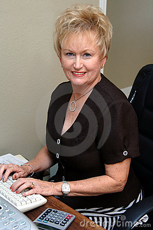 Free Senior Woman Working In Office Stock Photography - 2550772
