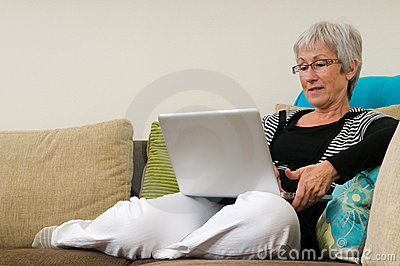 Senior woman working on a laptop