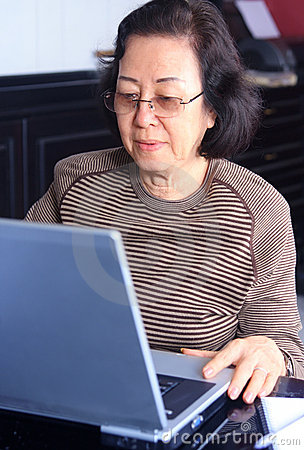 Free Senior Woman Working On A Laptop Stock Photography - 5467602