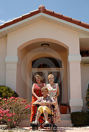 Senior women in front of home