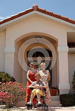 Senior women in front of home