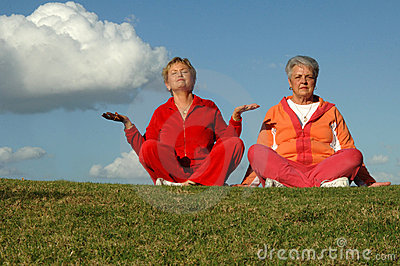 Senior women yoga outdoors
