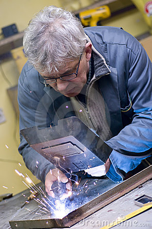 Free Senior Worker Welding Stock Photography - 4779442