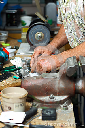Senior working in workshop