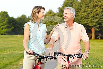 Seniors couple biking