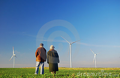 Seniors  couple and wind turbines