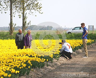 Senior couple visit the bulb route in the tulip fields, Noordoostpolder, Netherlands Editorial Image