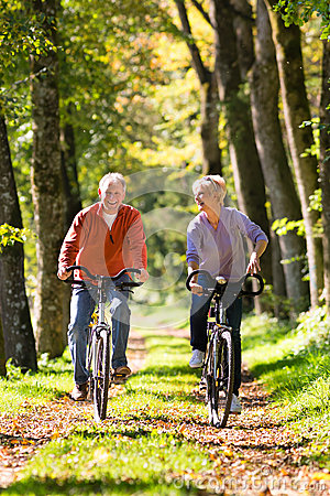 Free Seniors Exercising With Bicycle Royalty Free Stock Image - 29150946