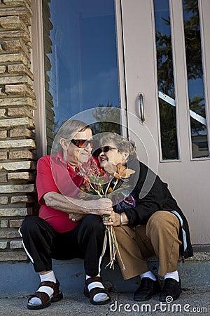 Seniors flirting offering flowers