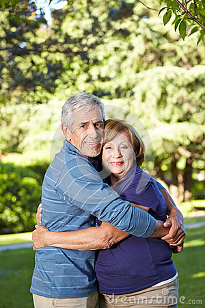 Seniors in love in a summer park