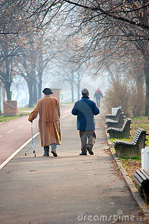 Seniors in a park walking