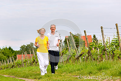 Seniors running in the nature doing sport