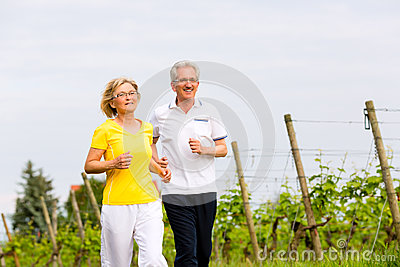 Seniors running in the nature doing sport