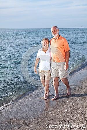 Free Seniors Stroll On Beach Stock Photo - 9910130
