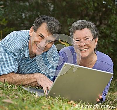 Free Seniors Surf The Web On Laptop Stock Image - 4328381