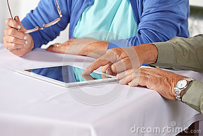 Seniors with tablet computer