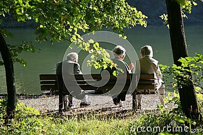 Seniors talking in the park