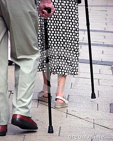 Seniors with walking sticks