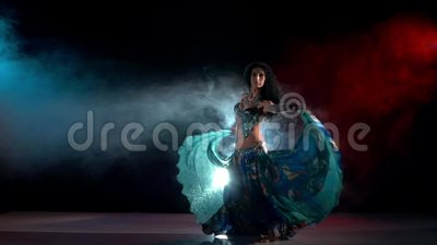 Sensetive belly dance movements of young and. Exotic, sensetive, belly dance movements of young, great and attractive girl in exotic dress, slow motion, in smoke stock footage