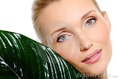 Sensitive beautyful woman face with a plant