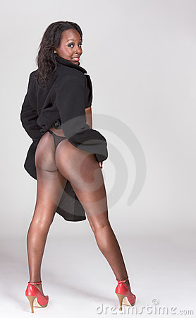 Sensual Afro American woman in coat showing butt