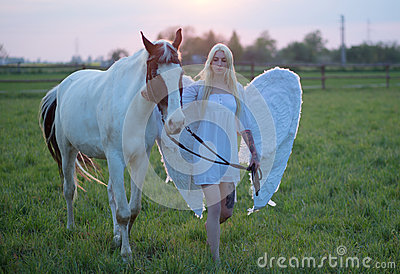 Sensual angel walking with the horse