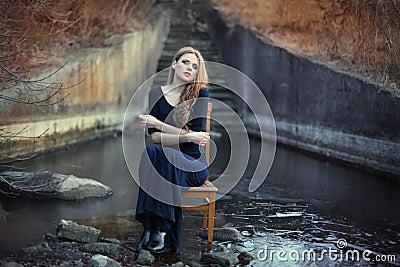 Sensual beautiful girl sitting on chair