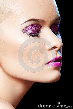 Sensual beauty model with shiny glitter make-up