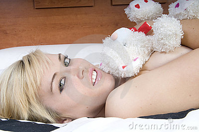 Sensual blonde woman on a bed