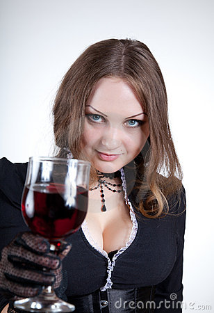 Sensual blue-eyed woman with glass of wine