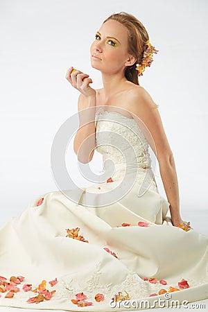 Sensual bride with rose petals