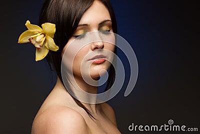 Sensual brunette on blue background