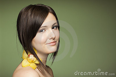 Sensual brunette on grenn background