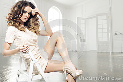 Sensual brunette woman in luxury room Stock Photo