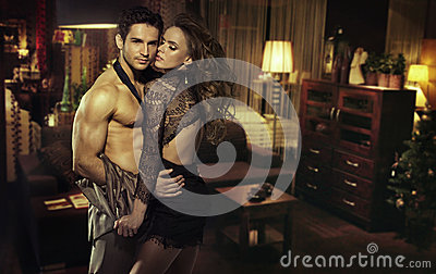 Sensual couple in romantic room