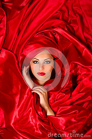 Sensual face  in red satin fabric