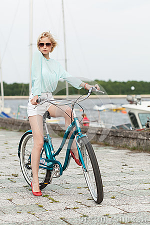 Sensual girl with bicycle