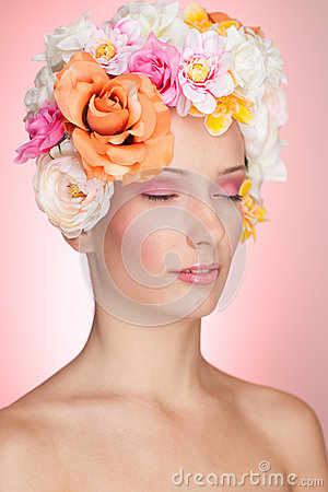 Sensual girl with flowers in hair