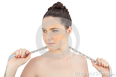 Sensual model holding measuring tape